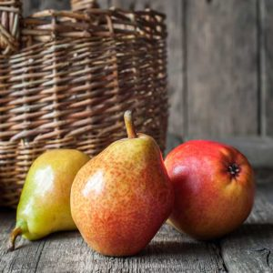 Three Northwestern Pears with basket in background