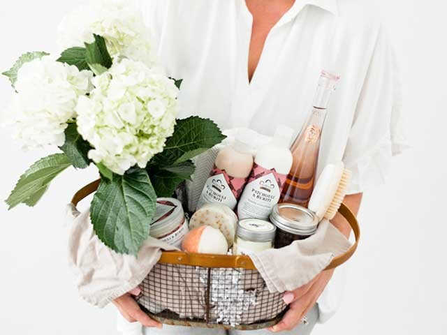 Woman holding gift basket.