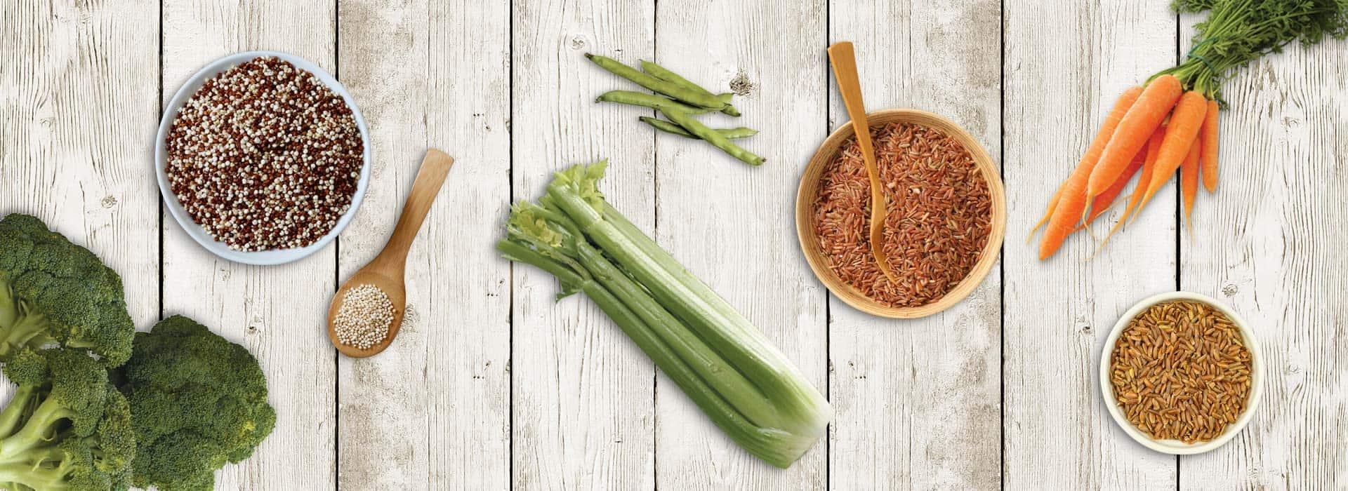 Ancient grains - Quinoa, rice and veggies on white wood