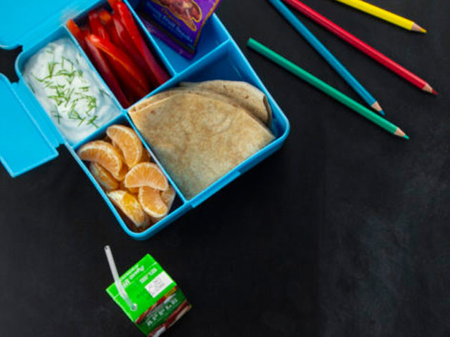 Lunch box, juice and colored pencils