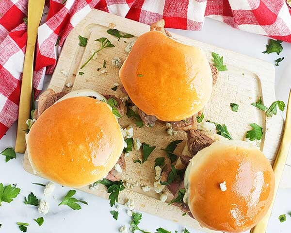 Sliders on a cutting board with checkered towel