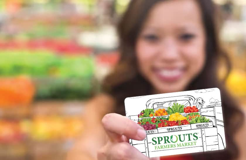 Girl smiling with Sprouts Gift Card